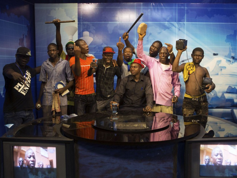Anti-government protesters take over the state TV podium in Ouagadougou